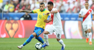 SAO PAULO, BRAZIL - JUNE 22: Dani Alves of Brazil and Christian Cueva of Peru during the Copa America Brazil 2019 group A match between Peru and Brazil at Arena Corinthians on June 22, 2019 in Sao Paulo, Brazil. (Photo by Alexandre Schneider/Getty Images)