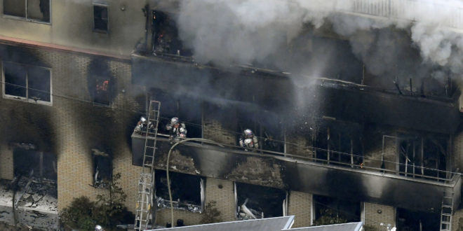 An aerial view shows firefighters battling the fires at the site where a man started a fire after spraying a liquid, at a three-story studio of Kyoto Animation Co. in Kyoto, western Japan, in this photo taken by Kyodo July 18, 2019. Mandatory credit Kyodo/via REUTERS ATTENTION EDITORS - THIS IMAGE WAS PROVIDED BY A THIRD PARTY. MANDATORY CREDIT. JAPAN OUT. NO COMMERCIAL OR EDITORIAL SALES IN JAPAN.     TPX IMAGES OF THE DAY